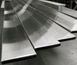 Finish, Deburr, Dress Welds, & Remove Weld Discoloration on Flat Bar and other components for the Metal Fabrication Industry