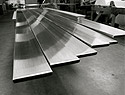 Finish, Deburr, Dress Welds & Remove Weld Discoloration on Flat Bar and Other Components for the Metal Fabrication Industry